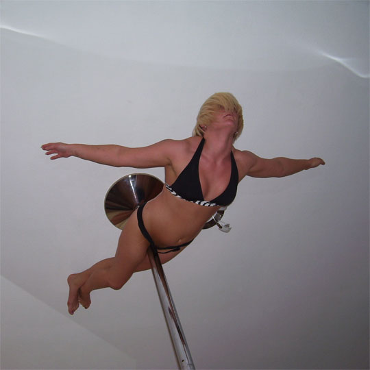 Pole Dancer Leanne Performing Pole Dancing Move Death Lay